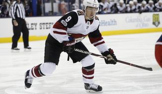 File- This Dec. 9, 2017, file photo shows Arizona Coyotes' Clayton Keller playing against the Columbus Blue Jackets during an NHL hockey game in Columbus, Ohio.  Keller got his rookie season off to a stellar start, hit a bit of a speed bump and has started created scoring opportunities again. He is one of several rookies who have had a big impact on their teams the first three months of the season. (AP Photo/Jay LaPrete, File)