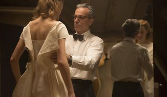 "In this image released by Focus Features, Vicky Krieps, left, and Daniel Day-Lewis appear in a scene from ""Phantom Thread."" (Laurie Sparham/Focus Features via AP)"