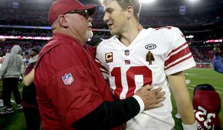 New York Giants quarterback Eli Manning (10) and Arizona Cardinals head coach Bruce Arians meet after an NFL football game, Sunday, Dec. 24, 2017, in Glendale, Ariz. The Cardinals won 23-0. (AP Photo/Rick Scuteri)