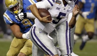 Kansas State quarterback Alex Delton (5) runs for a touchdown against UCLA in the first half during an NCAA college football Cactus Bowl game, Tuesday, Dec. 26, 2017, in Phoenix. (AP Photo/Rick Scuteri)