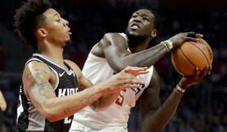 LA Clippers forward Montrezl Harrell, right, shoots around Sacramento Kings guard Malachi Richardson during the first half of an NBA basketball game in Los Angeles, Tuesday, Dec. 26, 2017. (AP Photo/Chris Carlson)