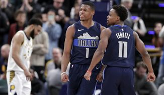 Dallas Mavericks guards Dennis Smith Jr. (1) and Yogi Ferrell (11) celebrate during the closing minute of the team's NBA basketball game against the Indiana Pacers in Indianapolis, Wednesday, Dec. 27, 2017. The Mavericks defeated the Pacers 98-94. (AP Photo/Michael Conroy)