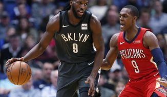 Brooklyn Nets forward DeMarre Carroll (9) drives past New Orleans Pelicans guard Rajon Rondo (9) in the first half of an NBA basketball game in New Orleans, Wednesday, Dec. 27, 2017. (AP Photo/Tyler Kaufman)