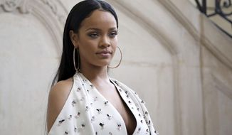 In this Sept. 30, 2016, photo, singer Rihanna poses for photographers as she arrives to Christian Dior's Spring-Summer 2017 ready-to-wear fashion collection presented in Paris. (AP Photo/Thibault Camus) **FILE**