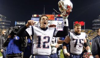 FILE - In this Sunday, Dec. 17, 2017, file photo, New England Patriots quarterback Tom Brady (12) celebrates with center Ted Karras (75) as they leave the field after defeating the Pittsburgh Steelers in an NFL football game in Pittsburgh. There is little doubt the quarterback any NFL coach or player would want leading the way to win a big game right now is Brady.  So it makes sense he was a nearly unanimous choice as the No. 1 quarterback in the league by an Associated Press panel. (AP Photo/Keith Srakocic, File)