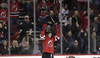 New Jersey Devils center Nico Hischier, of Switzerland, celebrates after scoring a goal against the Detroit Red Wings during the first period of an NHL hockey game Wednesday, Dec. 27, 2017, in Newark, N.J. (AP Photo/Julio Cortez)