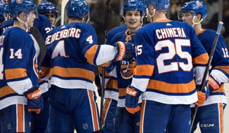 New York Islanders' Mathew Barzal, center right, celebrates with teammates after scoring the game winning goal in overtime against the Buffalo Sabres' during an NHL hockey game, Wednesday, Dec. 27, 2017, in New York. (AP Photo/Craig Ruttle)