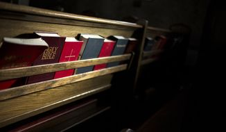 In a Dec. 14, 2017 photo, light falls on Bibles, hymnals and prayer books inside Saint Mark's Episcopal Church in Casper, Wyo. While suicide prevention has been a priority for the Episcopal church in Wyoming for years efforts have further intensified following state lawmakers drastic cuts of funding for prevention efforts earlier this year.   (Josh Galemore/The Casper Star-Tribune via AP)