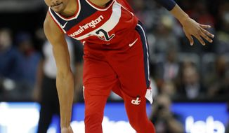 Washington Wizards' Otto Porter Jr., gestures after hitting a three-point basket in the second quarter of an NBA basketball game against the Atlanta Hawks in Atlanta, Wednesday, Dec. 27, 2017. (AP Photo/David Goldman)