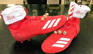 Alvin Kamara of the New Orleans Saints was fined by the NFL for wearing Christmas-inspired cleats during a Christmas Eve game against the Atlanta Falcons. (Image: Twitter, Alvin Kamara)