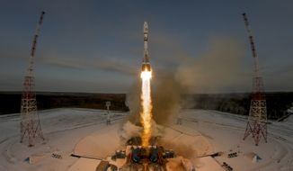 In this Tuesday, Nov. 28, 2017, file photo, a Russian Soyuz 2.1b rocket carrying the Meteor M satellite and additional 18 small satellites lifts off from the launch pad at the new Vostochny cosmodrome outside the city of Tsiolkovsky, about 200 kilometers (125 miles) from the city of Blagoveshchensk in the far eastern Amur region, Russia. The Kremlin says authorities are looking into recent failures in Russia's space industry. (AP Photo/Dmitri Lovetsky, File)