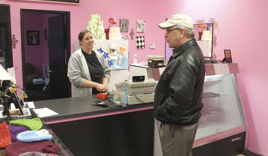 FILE - In this Feb. 5, 2013, file photo, Melissa Klein, co-owner of Sweet Cakes by Melissa, in Gresham, Ore., tells a customer that the bakery has sold out of baked goods for the day. An appellate court Thursday, Dec. 28, 2017, upheld a penalty against the bakery owners who refused to make a cake for a same-sex wedding almost five years ago. (Everton Bailey Jr./The Oregonian via AP, File)