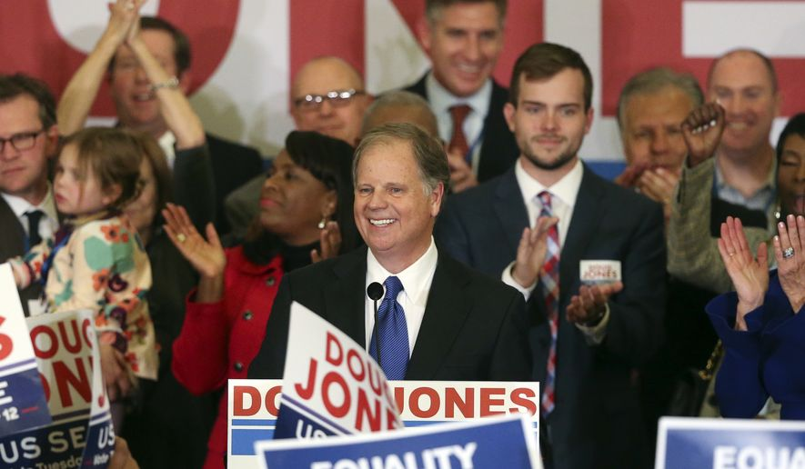 In this Tuesday, Dec. 12, 2017, file photo, Democrat Doug Jones speaks in Birmingham, Ala.  Roy Moore is going to court to try to stop Alabama from certifying Jones as the winner of the U.S. Senate race. Moore filed a lawsuit Wednesday evening, Dec. 27, 2017, in Montgomery Circuit Court. (AP Photo/John Bazemore, File)