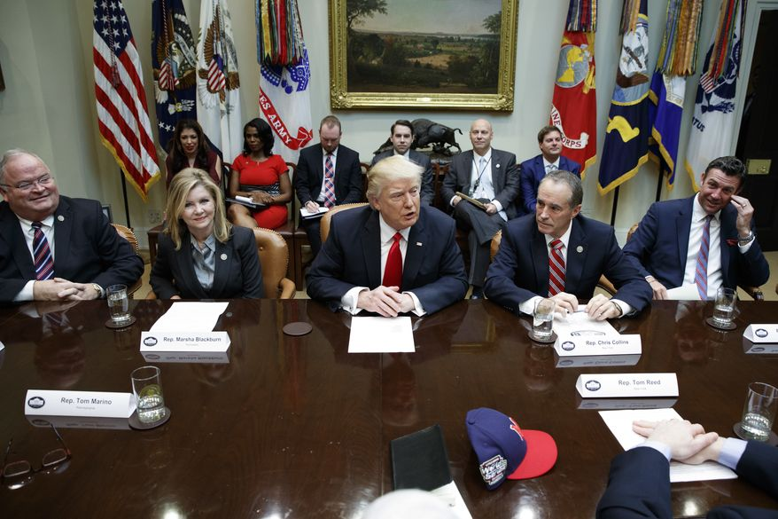 FILE - In this Feb. 16, 2017, file photo, President Donald Trump speaks during a meeting with House Republicans in the Roosevelt Room of the White House in Washington, Thursday, Feb. 16, 2017. From left are, Rep. Billy Long, R-Mo., Rep. Marsha Blackburn, R-Tenn., Trump, Rep. Chris Collins, R-N.Y., and Rep. Duncan Hunter, R-Calif. Trumps unpredictable, pugnacious approach to the presidency often worked against him as Republicans navigated a tumultuous but ultimately productive year in Congress. (AP Photo/Evan Vucci, File)