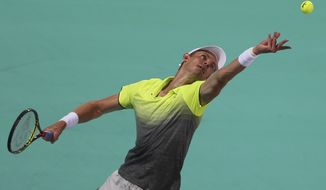 South Africa's Kevin Anderson serves the ball to Spain's Pablo Carreno Busta during the first day of the Mubadala World Tennis Championship in Abu Dhabi, United Arab Emirates, Thursday, Dec. 28, 2017. (AP Photo/Kamran Jebreili)