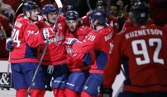 Washington Capitals defenseman John Carlson, left; left wing Alex Ovechkin, from Russia; right wing T.J. Oshie; and center Nicklas Backstrom, from Sweden, celebrate Ovechkin's goal during the second period of an NHL hockey game against the Boston Bruins, Thursday, Dec. 28, 2017, in Washington. (AP Photo/Alex Brandon)