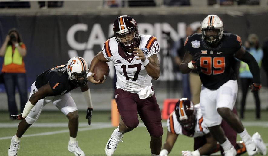 Virginia Tech quarterback Josh Jackson (17) scrambles away from Oklahoma State linebacker Calvin Bundage (1) and defensive end Trey Carter (99) during the first half of the Camping World Bowl NCAA college football game, Thursday, Dec. 28, 2017, in Orlando, Fla. (AP Photo/John Raoux) ** FILE **