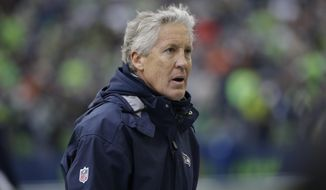 FILE - In this Dec. 17, 2017, file photo, Seattle Seahawks head coach Pete Carroll stands on the sideline in the first half of an NFL football game against the Los Angeles Rams in Seattle. Seattle (9-6) needs a victory and an Atlanta Cardinals loss to extend its playoff streak to six straight years. (AP Photo/Elaine Thompson, File)