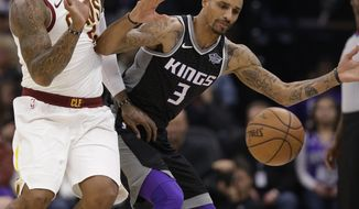 Cleveland Cavaliers guard J.R. Smith, left, and Sacramento Kings guard George Hill chase after the ball as it goes out of bounds during the first quarter of an NBA basketball game, Wednesday, Dec. 27, 2017, in Sacramento, Calif. (AP Photo/Rich Pedroncelli)