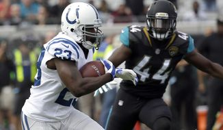 "FILE - In this Dec. 3, 2017, file photo, Indianapolis Colts running back Frank Gore (23) runs past Jacksonville Jaguars linebacker Myles Jack (44) for a short gain during the first half of an NFL football game in Jacksonville, Fla. On Wednesday, Gore and teammate Adam Vinatieri acknowledged they would each like to play another season, meaning Sunday's season finale against Houston won't become a retirement party. ""I know I still can play, and I know I want to help a team,"" Gore said. ""I don't want to just be part of a team, I want to help a team, and I don't want anyone to say I rode the bench to get a ring."" (AP Photo/John Raoux, File)"