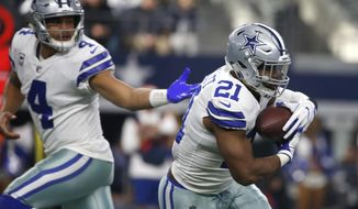 "FILE - In this Dec. 24, 2017, file photo, Dallas Cowboys quarterback Dak Prescott (4) hands the ball off to running back Ezekiel Elliott (21) during the first half of an NFL football game in Arlington, Texas. The Cowboys play the Philadelphia Eagles this week. Elliott needs 120 yards rushing to reach 1,000 in only 10 games. The Eagles have the NFL's top-ranked run defense and haven't allowed a 100-yard rusher since Matt Jones ran for 135 yards in Week 6 last year. ""If it happens, it happens,"" Elliott said. ""It's not like you can go out there and force that, but it definitely would be nice."" (AP Photo/Ron Jenkins, File)"