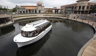 This Aug. 1, 2014, photo shows a Water Cruiser boat in The Woodlands development in The Woodlands, Texas.  One of the most iconic features of The Woodlands is back in action after a nearly four-month hiatus caused by Hurricane Harvey.  (Mayra Beltran/Houston Chronicle via AP)