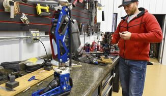 In this Dec. 22, 2017, photo, Mike Schultz, owner of BioDapt, works on a performance prosthetic for an athlete in his shop in St. Cloud, Minn. (Jason Wachter/St. Cloud Times via AP)