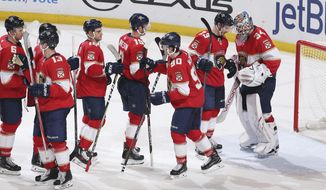 Florida Panthers goaltender James Reimer (34) celebrates a victory over the Philadelphia Flyers with teammates after the third period of an NHL hockey game, Thursday, Dec. 28, 2017, in Sunrise, Fla. (AP Photo/Joel Auerbach)