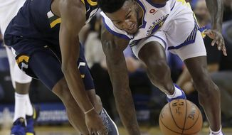 Golden State Warriors forward Jordan Bell, right, chases a loose ball next to Utah Jazz guard Alec Burks during the first half of an NBA basketball game in Oakland, Calif., Wednesday, Dec. 27, 2017. (AP Photo/Jeff Chiu)