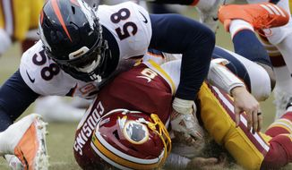 FILE - In this Dec. 24, 2017, file photo, Denver Broncos outside linebacker Von Miller (58) tackles Washington Redskins quarterback Kirk Cousins during an NFL football game in Landover, Md. The Broncos (5-10) have not been to the playoffs since Miller's MVP performance in Super Bowl 50, when his two strip sacks of Cam Newton ignited Denver's 24-10 win over Carolina on Feb. 7, 2016. (AP Photo/Mark Tenally, File)