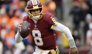 File- This Dec. 24, 2017, file photo shows Washington Redskins quarterback Kirk Cousins scrambling during an NFL football game in Landover, Md. Cousins will make his 48th consecutive start for the Redskins. It could be his last depending on which path his seemingly never-ending free agent saga takes this off-season.  (AP Photo/Mark Tenally, File)