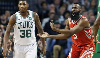 Houston Rockets' James Harden (13) protests a call beside Boston Celtics' Marcus Smart (36) during the first quarter of an NBA basketball game in Boston, Thursday, Dec. 28, 2017. (AP Photo/Michael Dwyer)