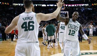 Boston Celtics' Terry Rozier (12) and Marcus Smart (36) celebrate after defeating the Houston Rockets in an NBA basketball game in Boston, Thursday, Dec. 28, 2017. (AP Photo/Michael Dwyer)