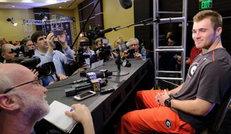 Georgia quarterback Jake Fromm answers questions from reporters during a news conference in Los Angeles on Thursday, Dec. 28, 2017. Georgia will take on Oklahoma on Monday, Jan. 1, 2018. (AP Photo/Richard Vogel)