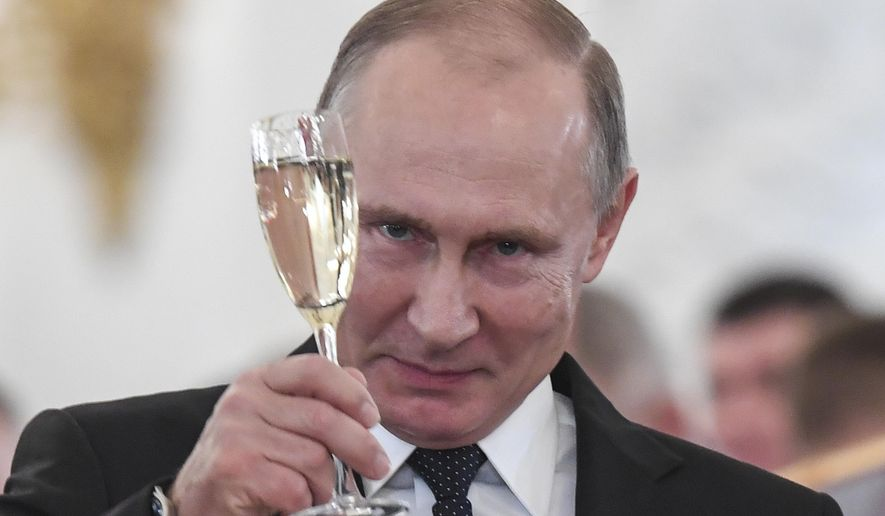 Russian President Vladimir Putin makes a toast during an award ceremony in the Kremlin, in Moscow, Russia, Thursday, Dec. 28, 2017, for Russian Armed Forces service personnel who took part in the anti-terrorist operation in Syria. (Kirill Kudryavtsev/Pool Photo via AP) ** FILE **
