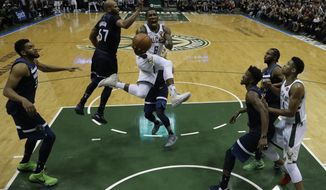 Milwaukee Bucks' Eric Bledsoe drives during the second half of an NBA basketball game against the Milwaukee Bucks Thursday, Dec. 28, 2017, in Milwaukee. The Bucks won 102-96. (AP Photo/Morry Gash)
