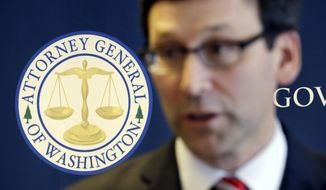 FILE - In this March 6, 2017, file photo, the logo for the Washington State Attorney General's office stands behind as Attorney General Bob Ferguson speaks at a news conference, in Seattle. Washington taking the lead among states in legal battles against President Trump's travel ban was voted the state's top news story of 2017 by Associated Press member editors and AP staff. (AP Photo/Elaine Thompson, File)