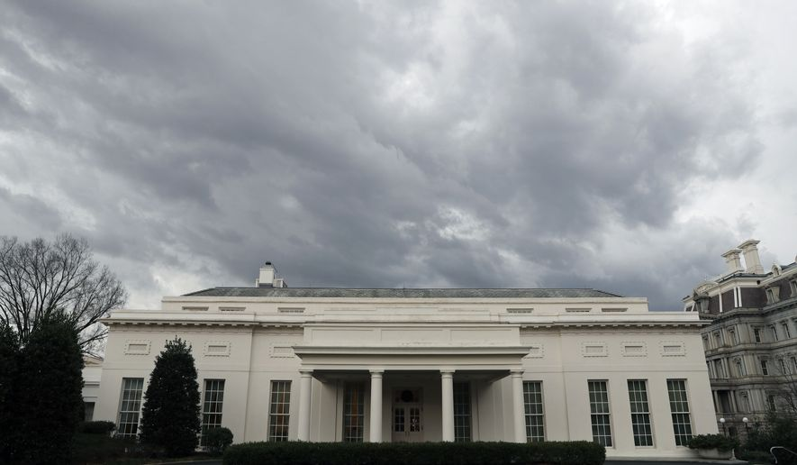 Storm clouds are seen over the West Wing of the White House as a cold front passes through the area, Saturday, Feb. 25, 2017, in Washington. (AP Photo/Alex Brandon)
