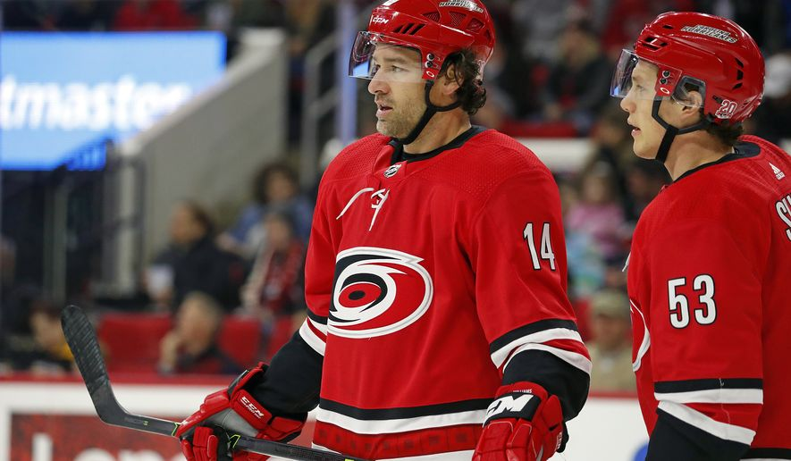 Carolina Hurricanes' Justin Williams (14) and Jeff Skinner (53) wait for a face-off against the Montreal Canadiens during the first period of an NHL hockey game, Wednesday, Dec. 27, 2017, in Raleigh, N.C. (AP Photo/Karl B DeBlaker)