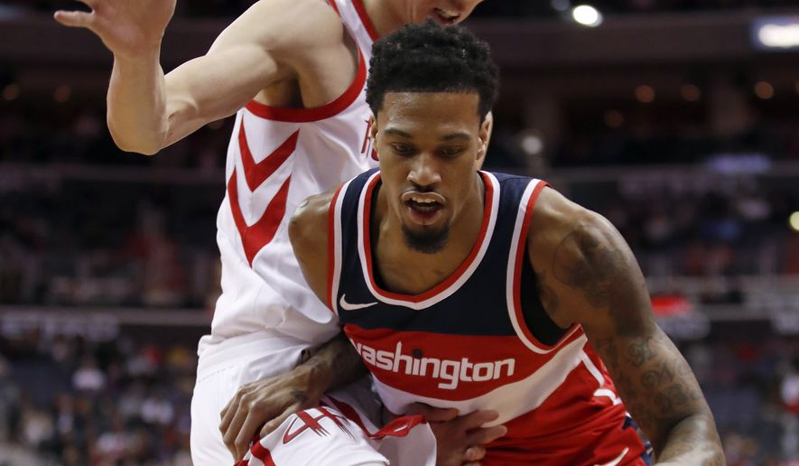 Washington Wizards forward Chris McCullough (1) drives against Houston Rockets forward Zhou Qi (9) during the second half of an NBA basketball game Friday, Dec. 29, 2017, in Washington. The Wizards won 121-103. (AP Photo/Alex Brandon)