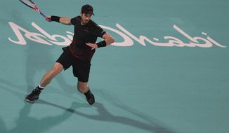 Great Britain's Andy Murray returns a ball to Spain's Roberto Bautista Agut during the second day of the Mubadala World Tennis Championship in Abu Dhabi, United Arab Emirates, Friday, Dec. 29, 2017. (AP Photo/Kamran Jebreili)