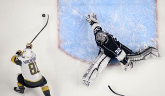 Los Angeles Kings goalie Jonathan Quick, right, gives up a goal to Vegas Golden Knights center Jonathan Marchessault during the second period of an NHL hockey game Thursday, Dec. 28, 2017, in Los Angeles. (AP Photo/Mark J. Terrill)