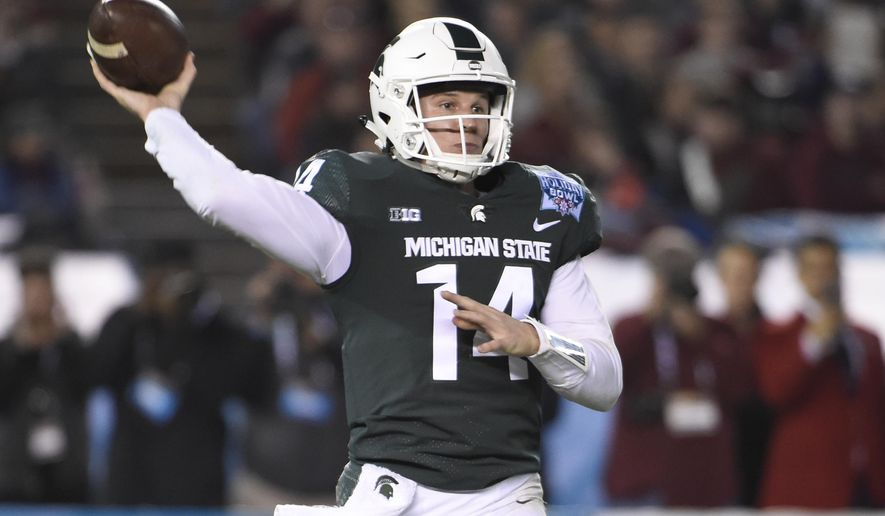 Michigan State quarterback Brian Lewerke throws during the first half of the Holiday Bowl NCAA college football game against Washington State on Thursday, Dec. 28, 2017, in San Diego. (AP Photo/Denis Poroy)