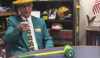 """In this Dec. 6, 2017, photo, Outagamie County Circuit Court Judge John Des Jardins talks about his Green Bay Packers-themed gavel at his chambers in Appleton, Wis. Des Jardins attended the coldest NFL game on record between the Dallas Cowboys and Green Bay Packers 50 years ago at Lambeau Field, a game that became known as the """"Ice Bowl."""" (AP Photo/Genaro C. Armas)"""