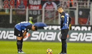 Inter Milan's captain Mauro Icardi, right, and teammate Martins Eder react after AC Milan's Patrick Cutrone, not shown, scored for his team during an Italian Cup quarter-final soccer match between Milan and Inter Milan at the San Siro stadium in Milan, Italy, Wednesday, Dec. 27, 2017. (AP Photo/Antonio Calanni)