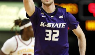 Kansas State forward Dean Wade celebrates after making 3-point basket during the second half of an NCAA college basketball game against Iowa State, Friday, Dec. 29, 2017, in Ames, Iowa. (AP Photo/Charlie Neibergall)