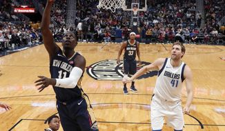 New Orleans Pelicans guard Jrue Holiday (11) goes to the basket in the first half of an NBA basketball game against the Dallas Mavericks in New Orleans, Friday, Dec. 29, 2017. (AP Photo/Gerald Herbert)