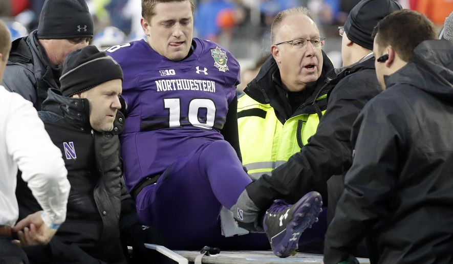 Northwestern quarterback Clayton Thorson (18) is put on a cart to be taken off the field after being injured in the first half of the Music City Bowl NCAA college football game against Kentucky, Friday, Dec. 29, 2017, in Nashville, Tenn. (AP Photo/Mark Humphrey)