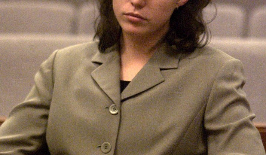 FILE - In this May 8, 2002, file photo, Kirstin Blaise Lobato awaits opening statements in her trial on charges of killing and sexual mutilation of a homeless man in Las Vegas in 2001. Lobato, who was twice convicted of a 2001 murder and sexual mutilation that she maintained happened while she was more than 150 miles away was exonerated Friday, Dec. 29, 2017, by a state judge in Las Vegas. (Las Vegas Review-Journal via AP, File)