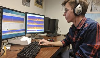 ADVANCE FOR SATURDAY, DEC. 30 -In this Wednesday, Dec. 6, 2017, photo, Colorado State University student Ben Buescher works in a laboratory at the college to chart noise pollution from recordings made in the nation's national parks, in Fort Collins, Colo. The college's listening lab analyzes recordings from the nation's parks in an effort to combat man-made noise pollution. (Sam Brasch/Colorado Public Radio via AP)